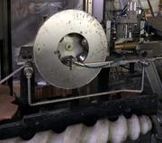 Автомат обкатки полиламинатного колпачка